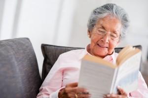 Elder woman reading a book