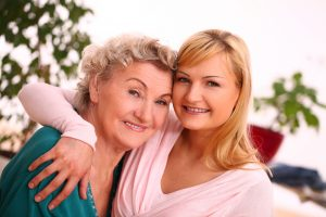 Happy elderly woman with granddaughter at home