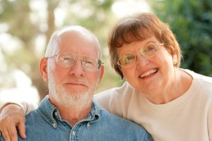 Happy Affectionate Smiling Senior Couple Outdoor Portrait